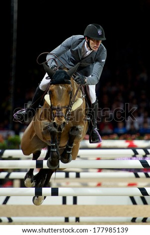 HONG KONG - FEB 21 2014 : French rider Kevin Staut with his 10-year-old mare Quismy des Vaux in action on Longines Speed Challenge of Longines Hong Kong Masters at AsiaWorld-Expo in Hong Kong    - stock photo
