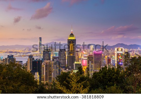 HONG KONG - FEB 9, Hong Kong skyline at Victoria Harbour, Hong Kong on 9 February, 2016. It has the Chinese New Year decorations on the buildings.  - stock photo