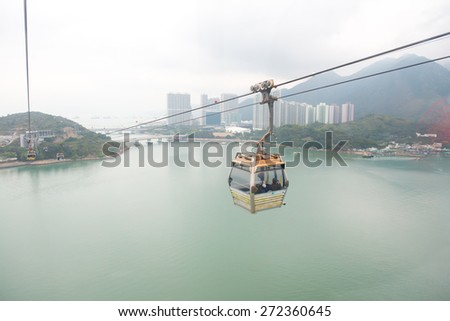 HONG KONG - FEBRUARY 07 : cable car ride to Lantau Island in Hong Kong on February 07 2015. Lantau is the largest island in Hong Kong, located at the mouth of the Pearl River. - stock photo