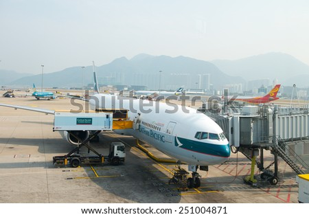 HONG KONG - FEBRUARY 07: Cathay Pacific Boeing 777-300ready for boarding in Hong Kong Airport on February 07, 2015. Cathey Pacific was founded in 1946 and became one of the famous airline in Hong Kong - stock photo