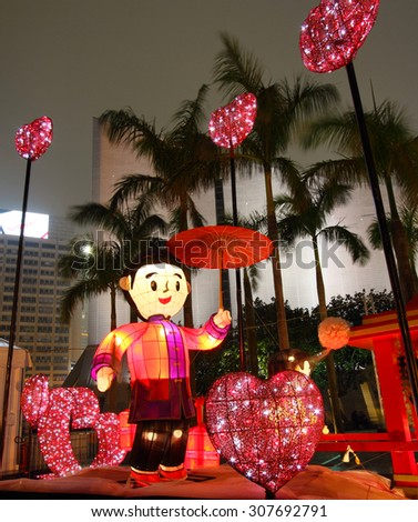 HONG KONG - FEBRUARY 16, 2014: Chinese lanterns with the theme of Asian wedding light up to celebrate the valentine's day on February 16, 2014 in Hong Kong. - stock photo