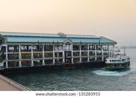 "HONG KONG - FEBRUARY 22: Ferry ""Day Star"" arriving Kowloon pier on February 22, 2012 in Hong Kong, China. Hong Kong ferry is in operation for more than 120 years and is one main tourist attractions. - stock photo"