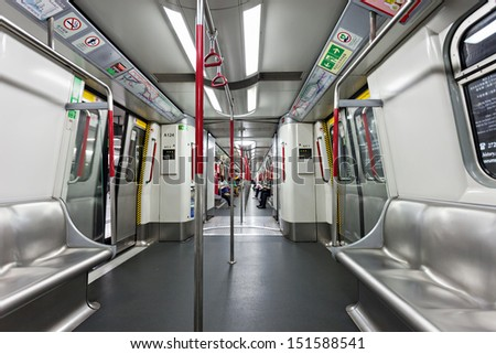 HONG KONG - FEBRUARY 22: Subway train interior on FEBRUARY 22, 2012 in Hong Kong. Over 90% daily travelers use public transport. Its the highest rank in the world. - stock photo