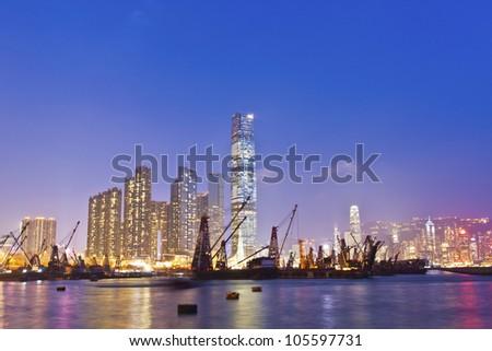 Hong Kong harbor at sunset - stock photo