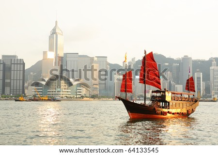 Hong Kong harbour with tourist junk - stock photo