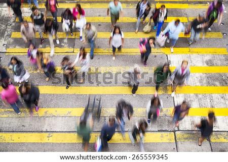 Hong Kong, Hong Kong SAR - November 13, 2014: Crowded pedestrian crossing during rush hour in Hong Kong. - stock photo