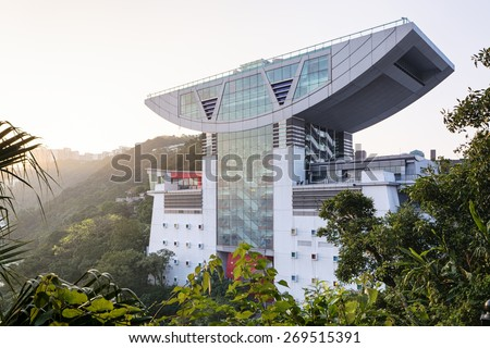 Hong Kong, Hong Kong SAR -November 15, 2014: The Peak Tower in Hong Kong. The Peak Tower is one of the most popular spot among tourist visiting Hong Kong. - stock photo