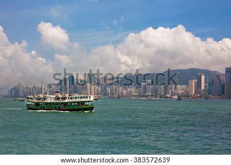 HONG KONG, HONG KONG - SEPTEMBER 22: famous ferry on Victoria harbor in Hong Kong with tall buildings on September 22, 2012