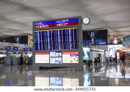 HONG KONG, INTERNATIONAL AIRPORT - 26 OCTOBER 2012: Airport timetable board in airport terminal - stock photo