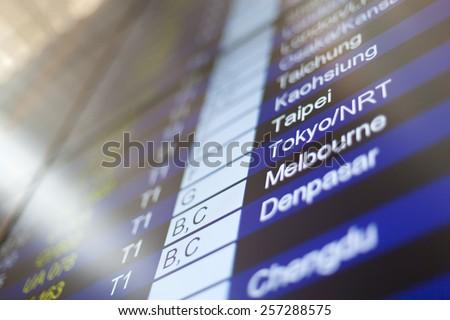 HONG KONG, INTERNATIONAL AIRPORT - 26 OCTOBER 2012: Arrival board in terminal. Tokyo in focus. - stock photo