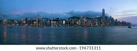 Hong Kong Island Central City Skyline Along Victoria Harbor Sunset Blue Hour Panorama - stock photo