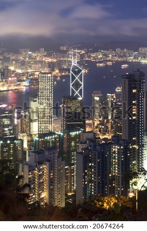 Hong Kong island photographed from Victoria's Peak at night. - stock photo