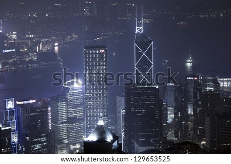 HONG KONG - JAN 4: View of modern skyscrapers in downtown Hong Kong, China on January 4,2013. Hong Kong is an international financial center that has 112 buildings that stand taller than 180 meters - stock photo