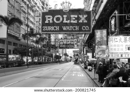 HONG KONG - JANUARY 4, 2012: B&W scene along the Nathan Road (Golden Mile), on the Kowloon side of Hong-Kong, China on January 4, 2012. China is a significant and increasing market for Swiss watches. - stock photo