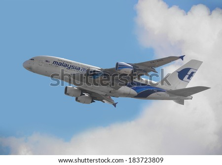 HONG KONG - JANUARY 11: Malaysia Airlines Airbus A380 departure from Hong Kong International Airport on January 11, 2014 in Hong Kong. Malaysia Airline is a flag carrier of Malaysia.  - stock photo