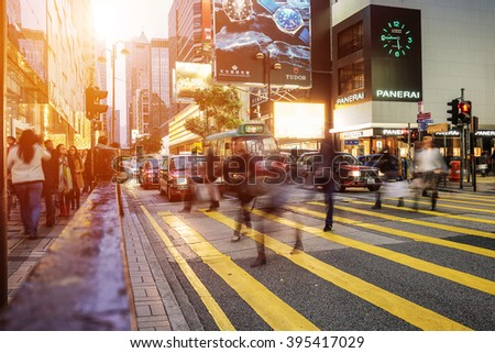HONG KONG - JANUARY 14: People speed walking across Road, Causeway Bay in front of a big department store at Daylight. Hong Kong January 14, 2016 - stock photo