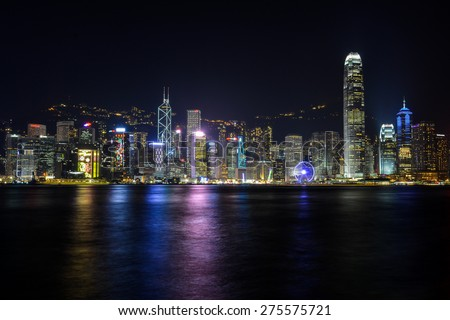 HONG KONG -JANUARY 22: Scene of Hong Kong skyline over the Victoria Harbour at night on January 22, 2015 in Hong Kong. Victoria Harbour is the famous attraction place for tourist to visit. - stock photo