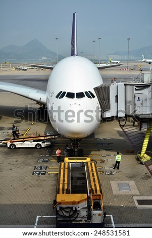 HONG KONG - JANUARY 28, 2015 :Thailand Airways Airbus A380. The Airbus A380 is a double-deck, wide-body, four-engine jet airliner manufactured by Airbus. It is the world's largest passenger airliner. - stock photo