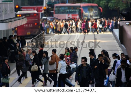 HONG KONG - JANUARY 14: the crowd in Causeway Bay on 14 January  2012. Hong Kong is one of the most densely populated areas in the world with an overall density of some 6,300 people per square km. - stock photo