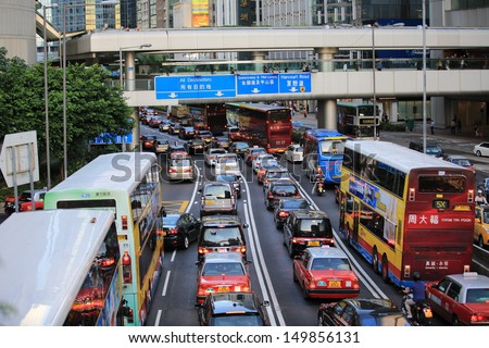 HONG KONG, JULY 10: the cars is in queue in the traffic jam in Central on 10 july 2013.  6 p.m. is the peak of rushing hour in central because all people come off work - stock photo