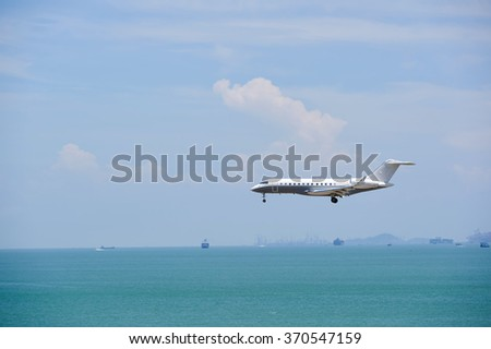 HONG KONG - JUNE 04, 2015: Bombardier Global Express aircraft landing at Hong Kong airport. The Bombardier Global Express is a large cabin, ultra long range business jet - stock photo