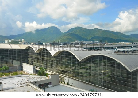 HONG KONG - JUNE 2014: Facade of Hong Kong International Airport terminal building, one of the world's busiest airport on June 19 2014 in Hong Kong - stock photo