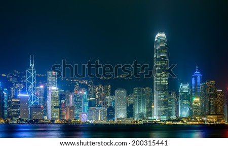 HONG KONG - June 14: Hong Kong city skyline at night over Victoria Harbor June 14 2014. Victoria Harbour is a natural landform harbour situated between Hong Kong Island and Kowloon in Hong Kong.
