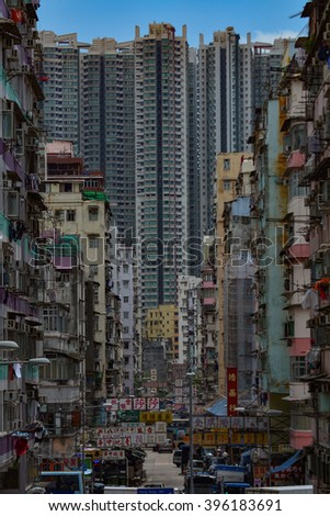 HONG KONG - JUNE 13, 2015 : Hong Kong high rise building and old buildings. Hong Kong is an autonomous territory on the southern coast of China at the Pearl River Estuary and the South China Sea.