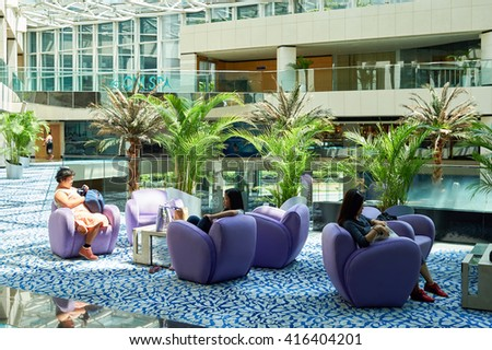 HONG KONG - JUNE 04, 2015: Regal Airport Hotel interior. Regal Airport Hotel directly linked to Hong Kong International Airport - stock photo