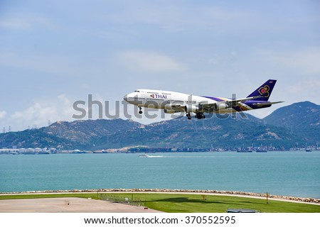 HONG KONG - JUNE 04, 2015: THAI aircraft landing at Hong Kong airport. Thai Airways International Public Company Limited, also trading as THAI is the flag carrier airline of Thailand - stock photo