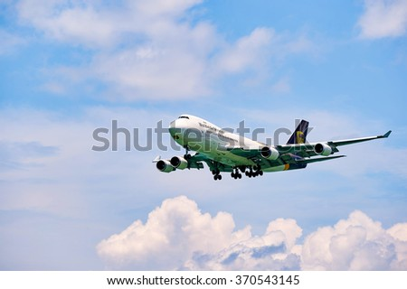 HONG KONG - JUNE 04, 2015: UPS Boeing 747 landing at Hong Kong airport. UPS is the world's largest package delivery company and a provider of supply chain management solutions