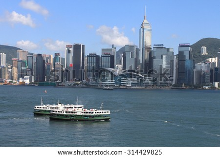HONG KONG - JUNE 30, 2013: View of Victoria harbour on June 30, 2013 in Hong Kong. The harbour viewed from Tsimshatsui is a landmark tourist spot in Hong Kong. - stock photo