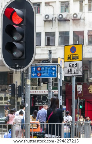 HONG KONG - MAR 30 : Asian women are the traffic lights to cross the road on Mar 30,2015 in HONG KONG - stock photo