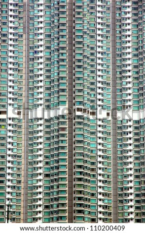 HONG KONG - MARCH 31: A residential building on March 31, 2012 in Hong Kong. With a population of seven million people, Hong Kong is one of the most densely populated areas in the world.
