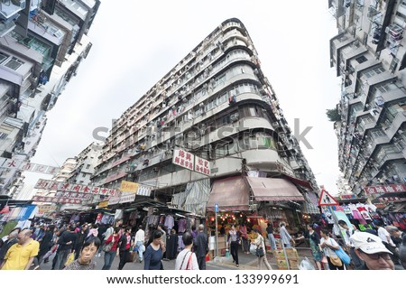 HONG KONG - MARCH 18 :Crowded residential in old district on March 18, 2013 in Hong Kong. With land mass of 1104 km and 7 million people, Hong Kong is one of most densely populated areas in the world - stock photo