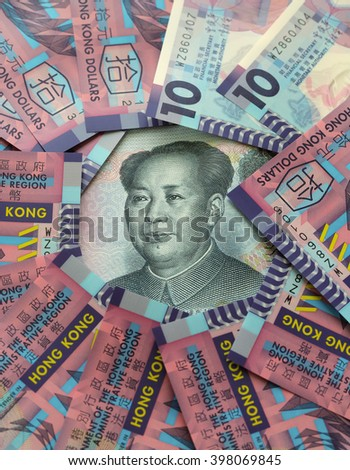 HONG KONG - MARCH 27, 2016: Hong Kong dollar juxtaposed against Chinese Yuan. Hong Kong and Mainland China adopt two different types of currencies under one country two systems. - stock photo