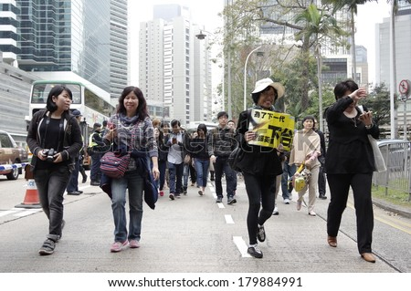 HONG KONG - March 2: 13000 of Hongkongers march to condemn the brutal knife attack on Kevin Lau Chun-To, ex-editor of Ming Pao, and support press freedoms on March 2, 2014 in Hong Kong.