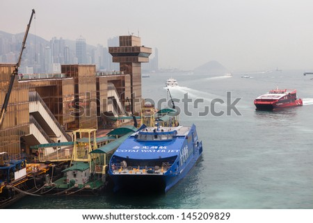 HONG KONG - MARCH 15: Passenger Ferry to China returns to Kowloon terminal, Hong Kong on March 15th, 2013  - stock photo