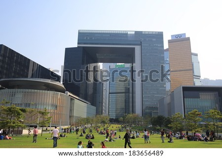 HONG KONG, MARCH 23: people go picnic on the grassland in front of Central Government Offices on 23 march 2014.or so called the Complex, Tamarit is the new location for the Government of Hong Kong . - stock photo