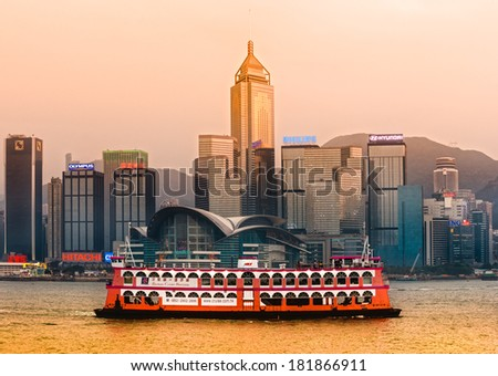 HONG KONG - MARCH 15: Victoria Harbor on March 15, 2013 in Hong Kong. A cruise ship departed from Ocean Terminal and drove across Victoria Harbor. - stock photo