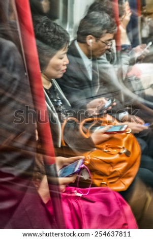 HONG KONG - MAY 7, 2014: Blurred scene of moving people in the subway. The public system is used by more than 90 percent of population. - stock photo