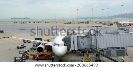 HONG KONG - MAY 16: Cargoes being unloaded from a Hong Kong Airlines at Hong Kong airport on May 16, 2014 in Hong Kong. Hong Kong Airlines is one of the most busy carriers in the region.