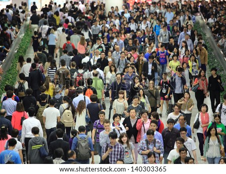 HONG KONG -MAY 13: Crowd of people, going in and out forward, in tunnel of Central MTR subway station on May 13 2013. 6 p.m. is the peak of rushing hour in central because all people come off work - stock photo