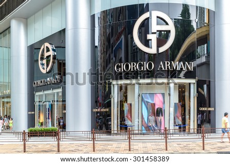 HONG KONG - MAY 2, 2015: Giorgio Armani signage above store entrance in Hong KOng. Giorgio Armani S.P.A. is an international Italian fashion house headquartered in Milan, Italy. - stock photo