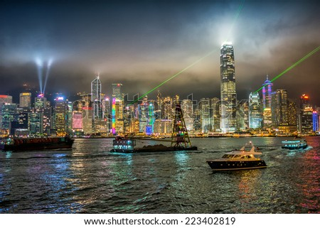 HONG KONG - MAY 6, 2014: Hong Kong night skyline at night. The city is a major tourist attraction with more than 30 million visitors every year. - stock photo