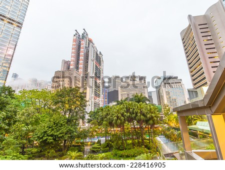 HONG KONG - MAY 11, 2014: Hong Kong skyline in the evening. The city is a major tourist attraction with more than 30 million visitors every year. - stock photo
