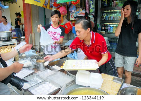 HONG KONG-MAY 24: Locals selling buns at the Bun Festival in Cheung Chau. The festival draws thousands of local and overseas tourists every year May 24, 2007 in Hong Kong. - stock photo