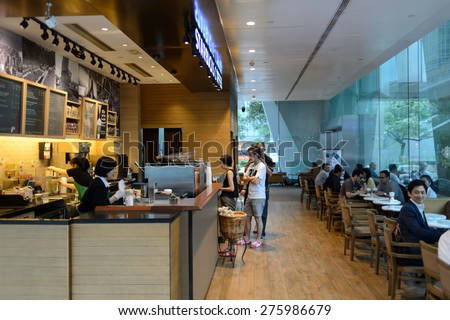 HONG KONG - MAY 05, 2015: Starbucks cafe interior. Starbucks is the largest coffeehouse company in the world, with more then 23000 stores - stock photo