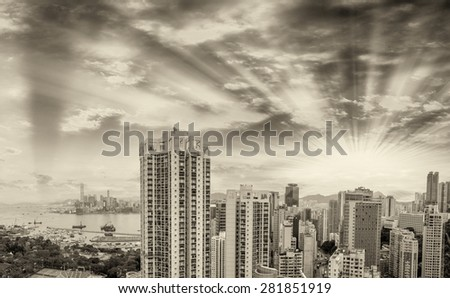 HONG KONG - MAY 12, 2014: Stunning panoramic view of Hong Kong Island and Kowloon on a cloudy day. Last year HK hosted more than 54 million visitors, most of them from the mainland.