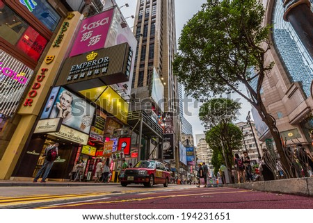 HONG KONG - MAY 18, 2014: Taxis on the street close to Times Square in Causeway Bay in Hong Kong. Over 90  daily travelers use public transport  Its the highest rank in the world. - stock photo
